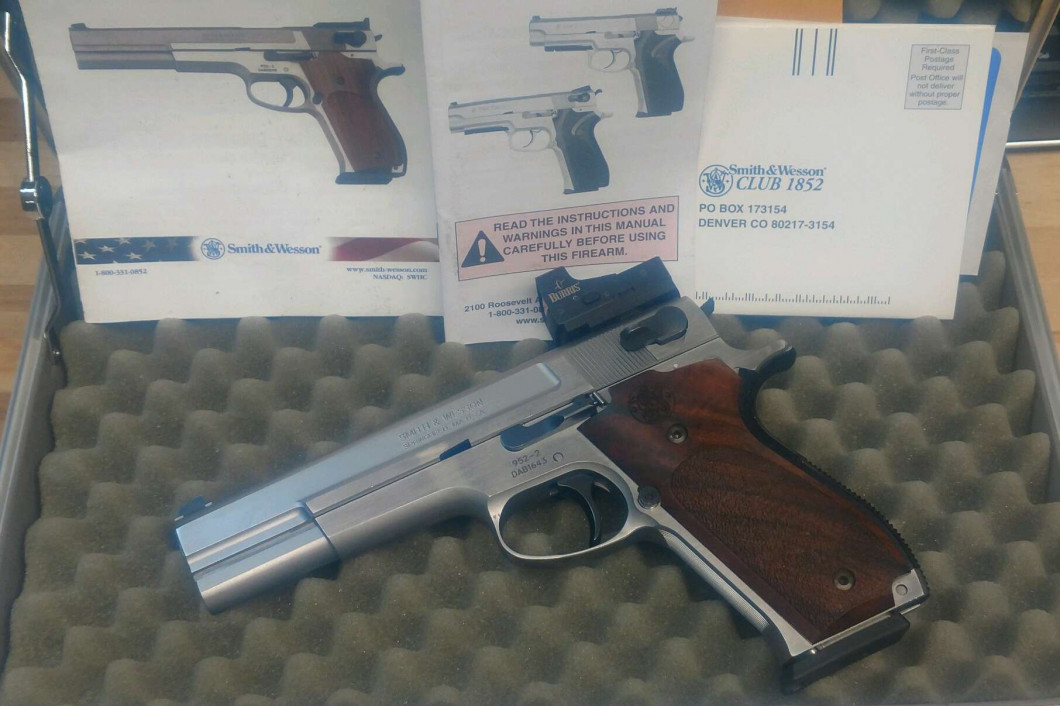 VERY RARE Smith and Wesson 952. This is the PERFORMANCE CENTER  9mm version of the Super Accurate Target Gun. Has Burris Fast Fire Red Dot and original rear sight. With original box and paperwork. Super Clean gun. $2099